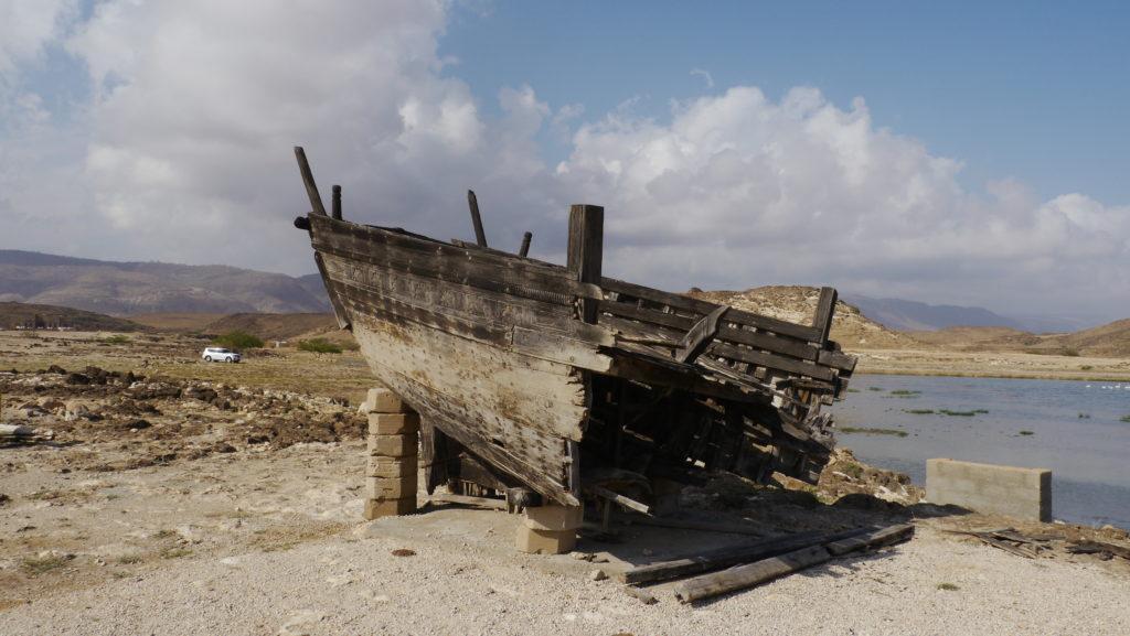 The remains of sambuq Dhib ship lie on the coast of lagoon Khor Rori under the ruins of Samharam Unesco site. Salalah East trip.