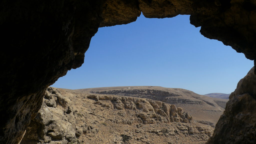 Mountain view from a cave in Dhofar Mountains. Day with camel herdsmen. Salalah trip.