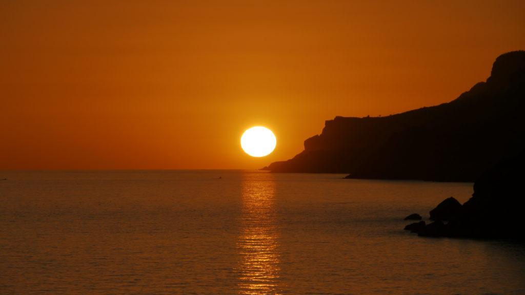 Sunset viewed from Dhalkut beach. Excursion from Salalah to Dhalkut. Dfofar West Coast Odyssey.
